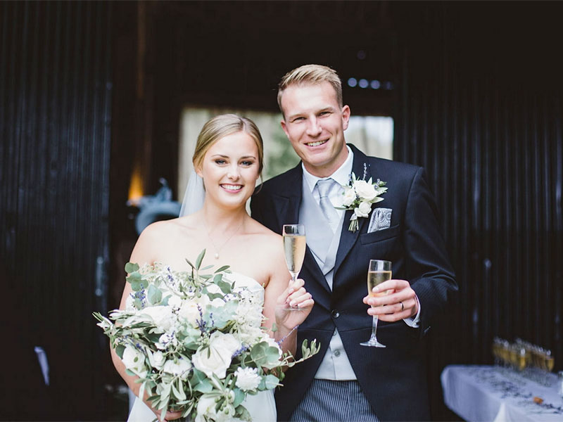 Happy couple at a rustic barn wedding in hampshire