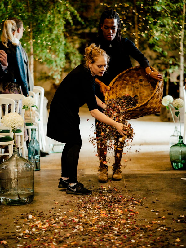 Scattering flowers at a rustic wedding