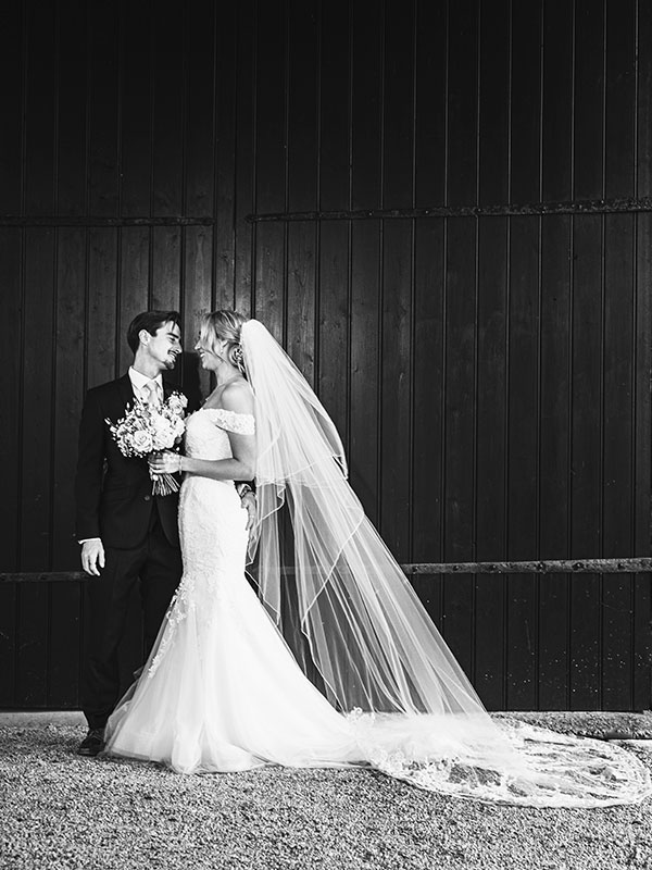 Happy couple in the rustic barn