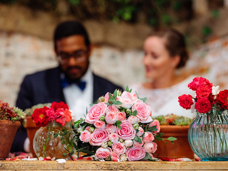 Signing the register at a rustic barn wedding in Hampshire